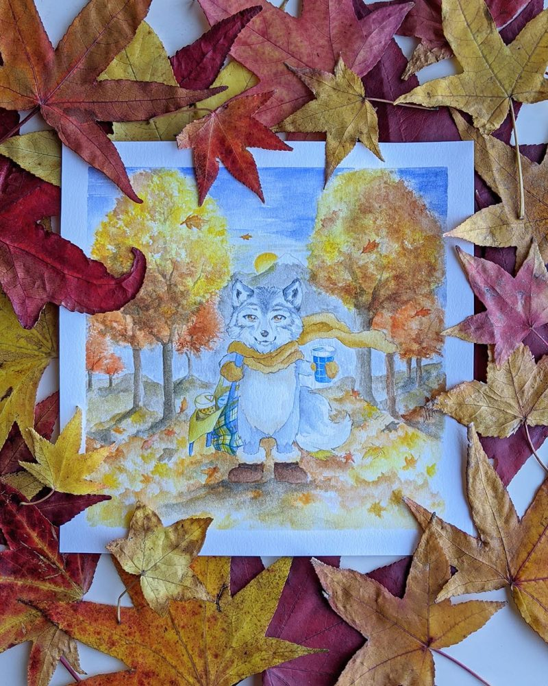 Forest animal wolf cute watercolor art with autumn leaves and tree landscape chibi furry anime drawing in scarf and gloves with hot coffee and maple
